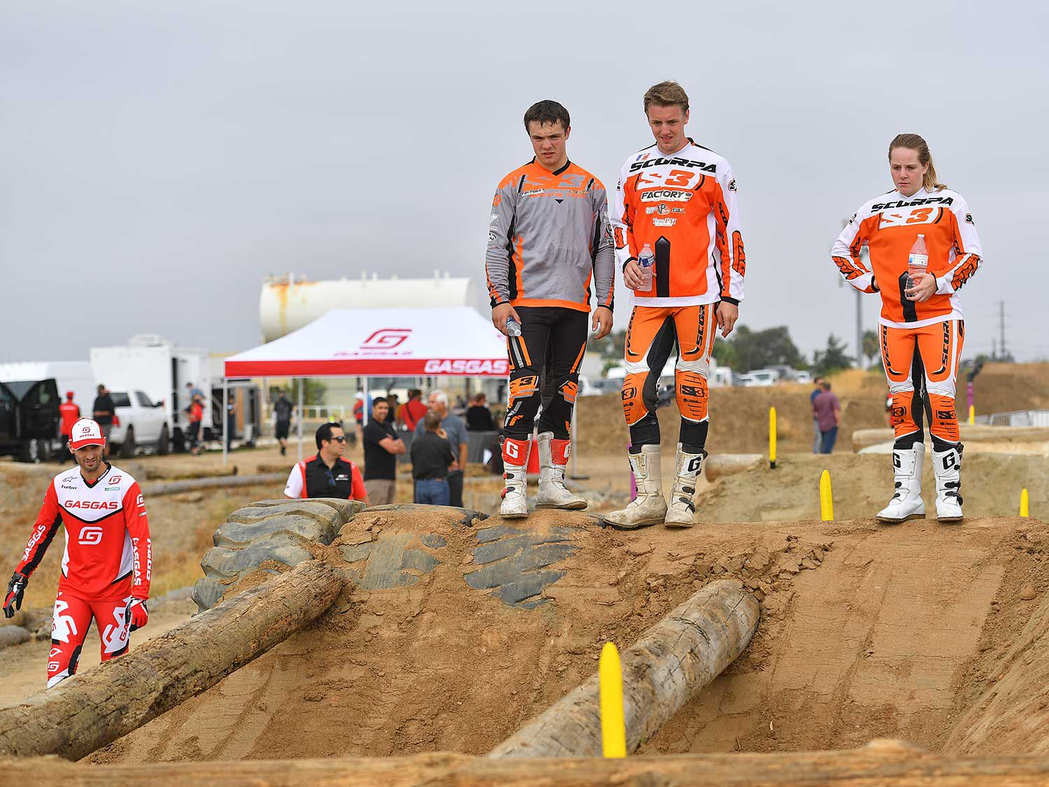 The Invitational strayed from normal trials format by incorporating a timed lap on part of the KTM/Husqvarna EnduroCross practice track, the fastest rider getting to start the main event last. That way, he (or she) could watch others be the guinea pigs and see which lines might be best. Here, from left, are Team Scorpa's Will and Alex Myers, and Kylee Sweeten.